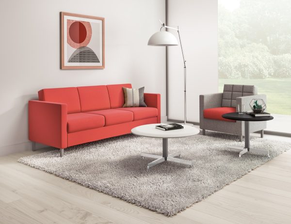 office design layout with red contemporary sofa and grey office chair
